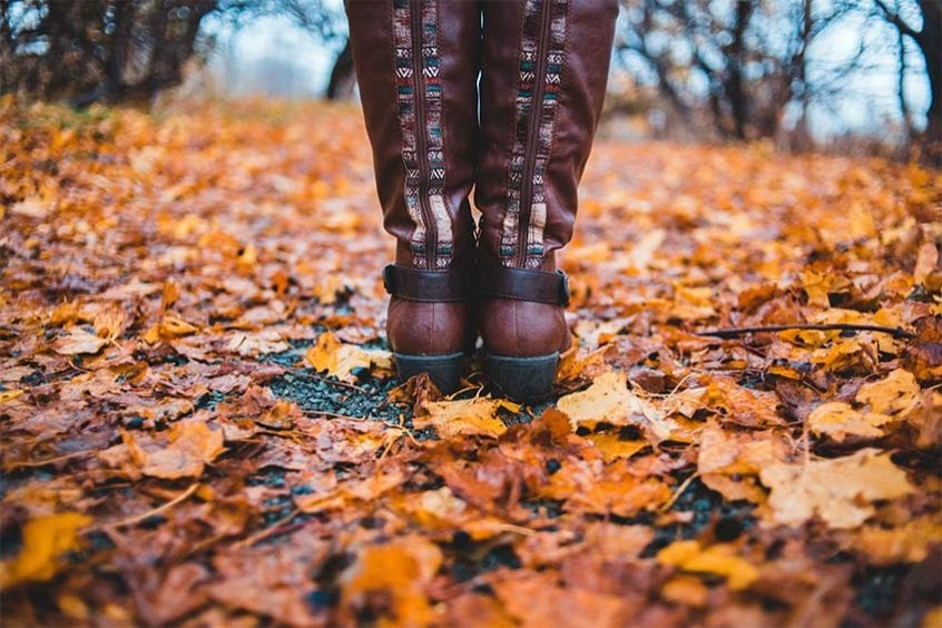 boots in the fall surrounded by leaves
