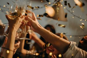 people toasting with confetti