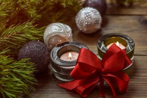 candles with red bow and greenery