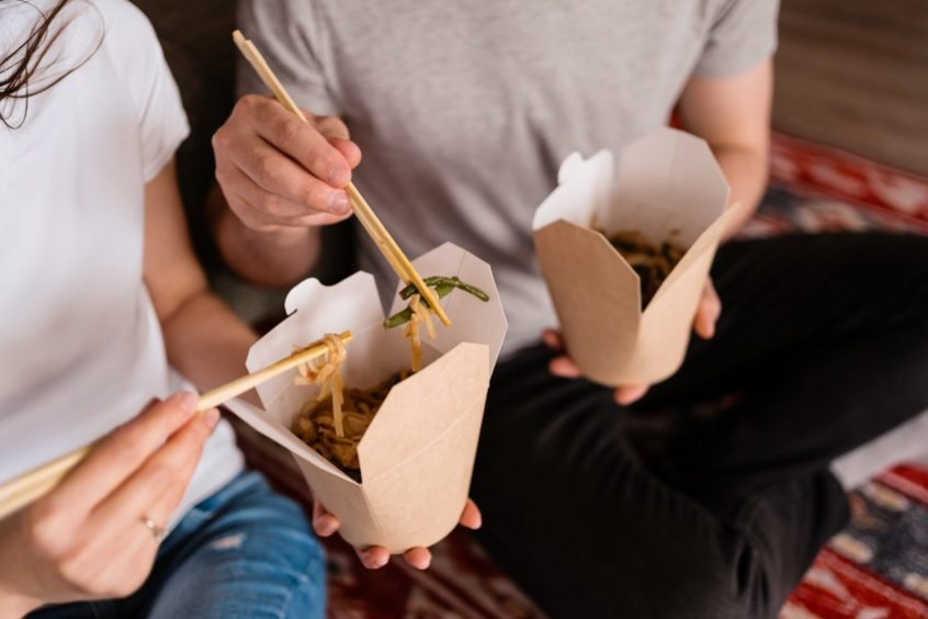 people eating takeout